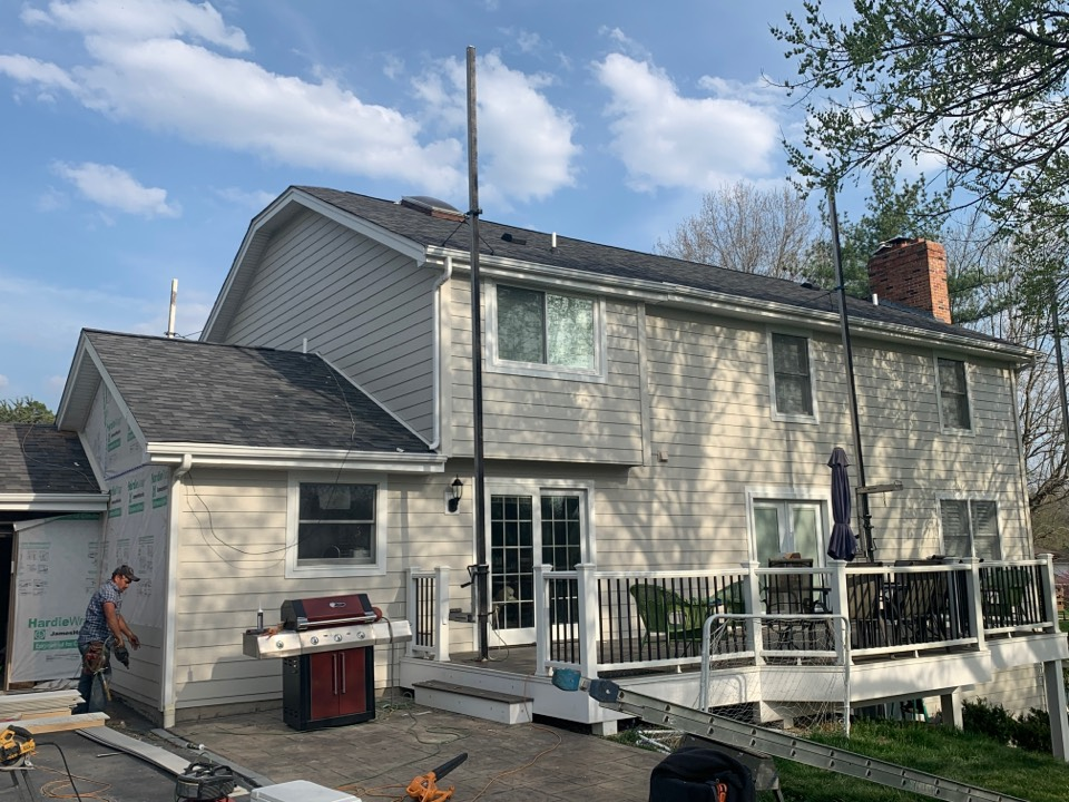 St. Louis, MO - We continue to make progress on this new James Hardie fiber cement siding project in Town & Country, MO. The client choose James Hardie lap siding, color = cobblestone with James Hardie arctic white trim around windows & doors.