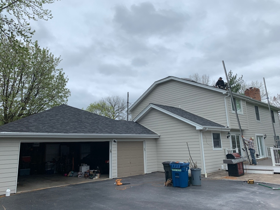 St. Louis, MO - We are finishing this James Hardie fiber cement siding install in Town & Country, MO. We installed James Hardie lap siding, color cobblestone with James Hardie trim, color arctic white. The client said she wished she installed new siding much sooner.