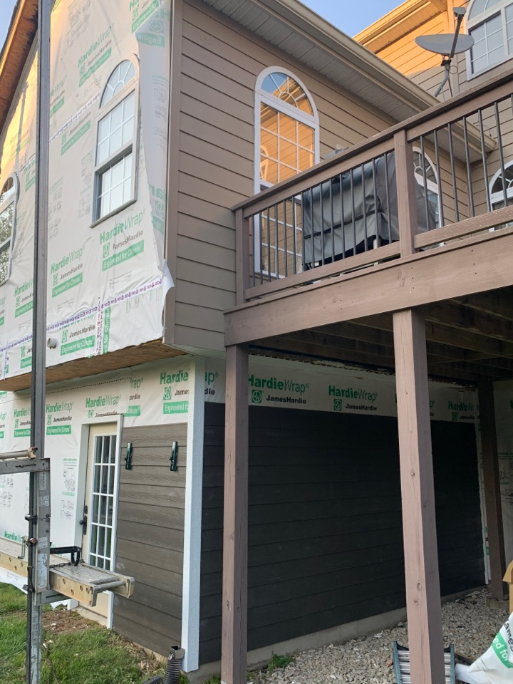 Wildwood, MO - We started a new James Hardie fiber cement siding project today in Wildwood, MO. The client choose James Hardie lap siding color = rich espresso with arctic white trim  to replace tan siding with tan trim. The client is very happy with our new siding start on day 1!