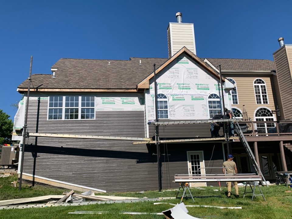 Wildwood, MO - Our James Hardie fiber cement siding project continues today. The client chose James Hardie lap siding, color = rich espresso with arctic white trim to replace tan color siding & trim.