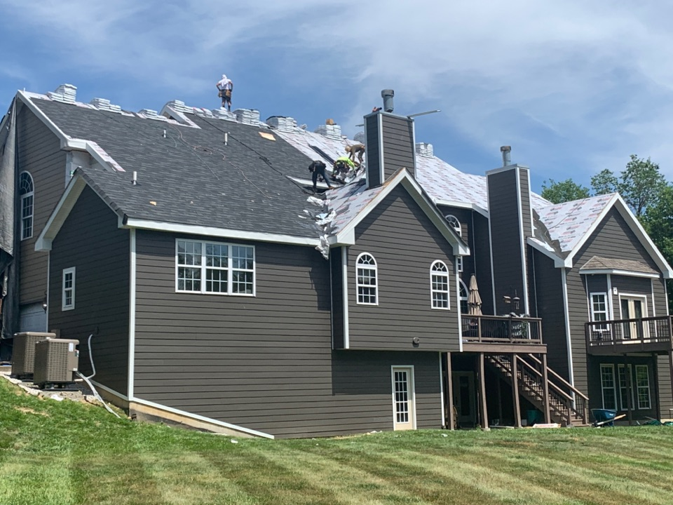 Wildwood, MO - We are installing a new roof today in Wildwood , MO. The client chose GAF Camelot 2 designer architectural shingles, color = charcoal. The client chose the new GAF Camelot roof shingle color to coordinate with their new James Hardie lap siding, color = espresso gray.