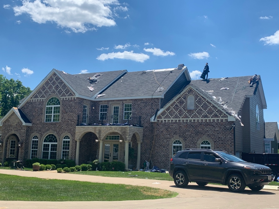 Wildwood, MO - We are installing a new designer asphalt shingle roof today in Wildwood, MO. The client chose GAF Camelot shingles, color = charcoal for their exterior makeover and told me they are very happy with the new color and also the work of our crew.