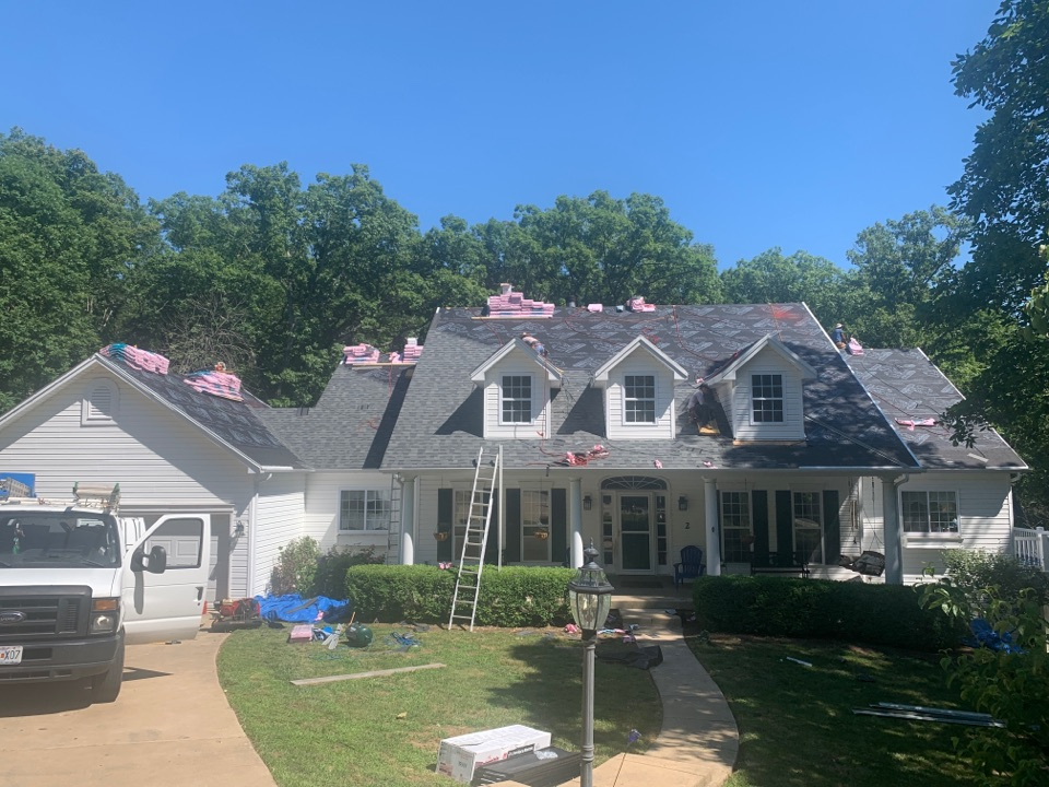 Defiance, MO - We are installing a new asphalt shingle roof today in Defiance, MO. The client chose Owens Corning Duration Flex architectural shingles, color = estate gray. The Flex shingles are impact resistant and will lower the client's homeowners insurance due to lower risk of hail damage to the Owens Corning Flex shingles.