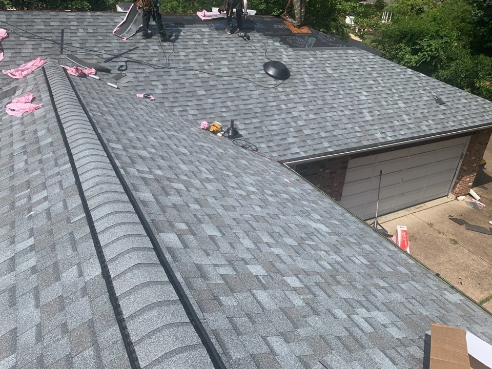 Saint Ann, MO - We are installing a new roof today in St. Ann, MO. The client chose Owens Corning Duration architectural z shingles, color = quarry gray. This is a hail damage claim paid for by insurance after the 7/9/21 hail storm in St. Louis County. We worked with the insurance company to get additional $800 covered by insurance for the client's roof. The client is happy with the 7 person crew and their work ethic.