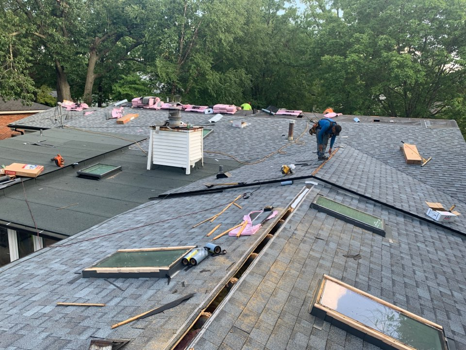 Creve Coeur, MO - We are installing a new roof and replacing 7 skylights today in Creve Coeur. It is a hail storm claim covered by insurance. The client chose Owens Corning Duration architectural shingles, color = quarry gray plus Velux skylights. The client was very happy we handled the instinct claim process for her.