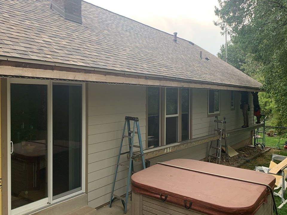 St. Louis, MO - This is day 2 of our LP SmartSide engineered wood siding install project in the Creve Coeur area. The siding color is desert stone and the trim color is terra brown. We also installed a new asphalt shingle roof 2 weeks ago, using Owens Corning Duration architectural shingles, color = sand dune.