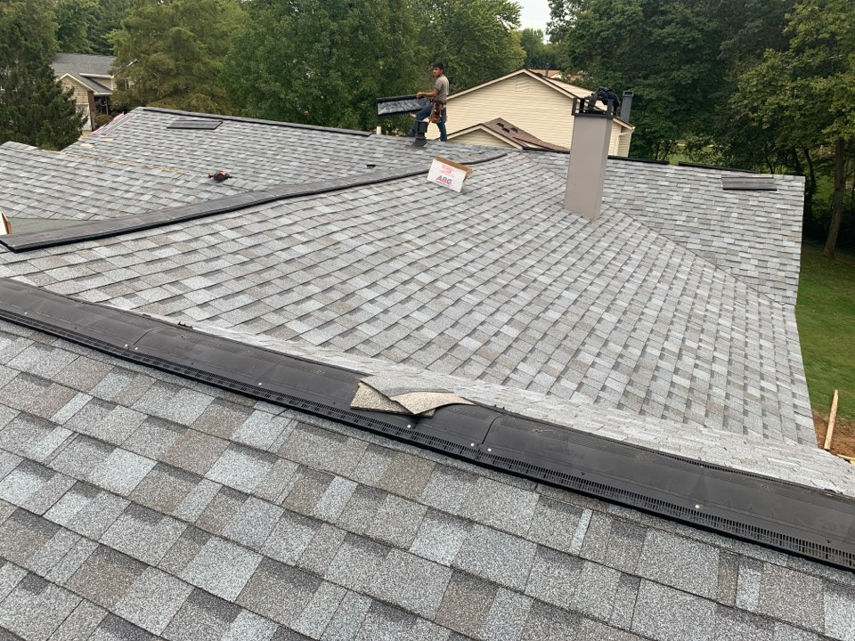 Saint Charles, MO - We are installing a new asphalt shingle roof today in St. Charles, MO. The client chose Owens Corning Duration architectural shingles, color = quarry gray plus Owens Corning VentSure continuous ridge vent for optimal roof ventilation. The client told me he was very happy with our roof crew.