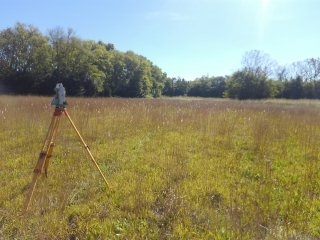 Retracement Survey of large tract of land. Located easements for utilities, property corners, and billboards for advertising.