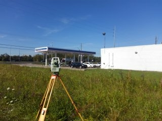 Performed a Retracement Survey of Marathon gas station in Montgomery, Alabama. Located structures and all utilities. Marked property corners with flagging and wood stakes.