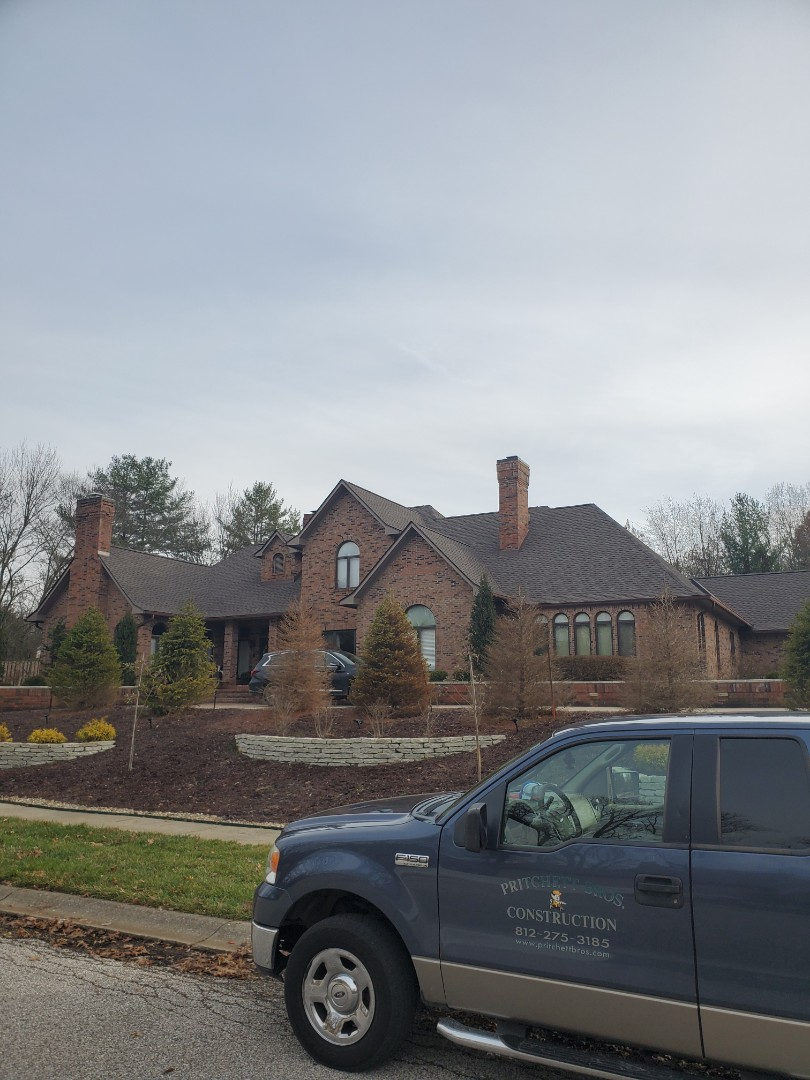 Bloomington, IN - It was a pleasure working with for this couple. Another completed roof, another happy customer. Great choice of color with the HD Mission Brown, goes great with the bricks.