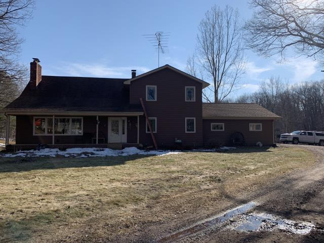 Lewis, WI - This past client wanted us to reside their house.