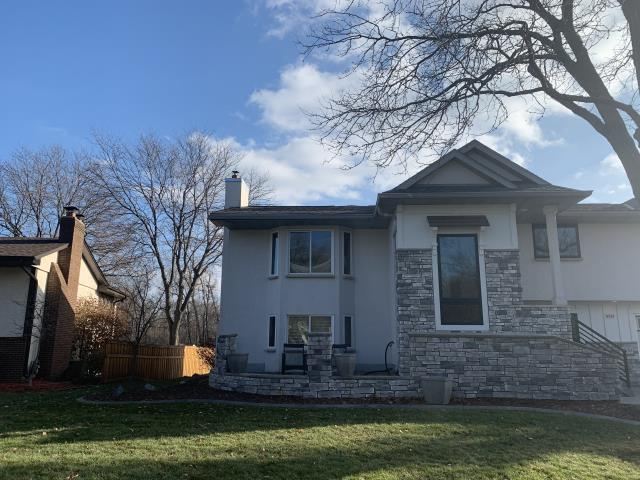Maple Grove, MN - Installed new gutters, repaired flat roof and did a roofing repair.
