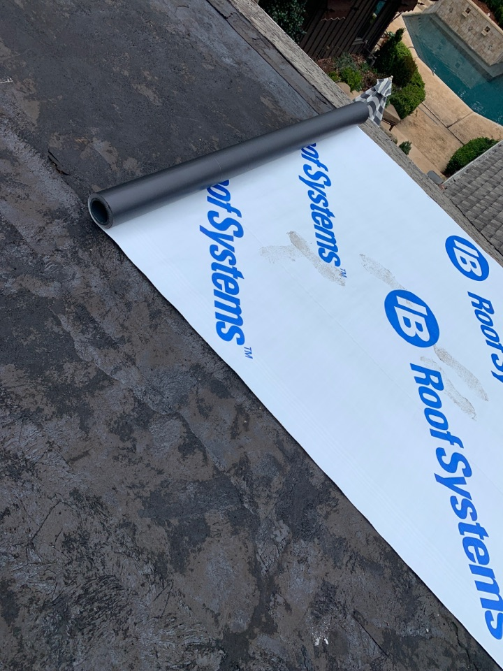 Columbus, GA - Superior Roofing is putting on PCV roofing on a house in Columbus Georgia today. In this picture we are putting a layer that is called the separation sheet.