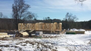 Apex, NC - First floor framing almost completely.   This new custom home will be spectacular.