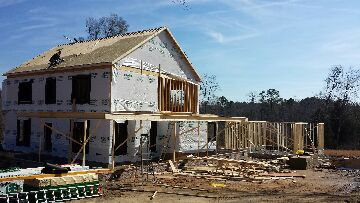 Apex, NC - getting the wrap around porch built on this custom home.