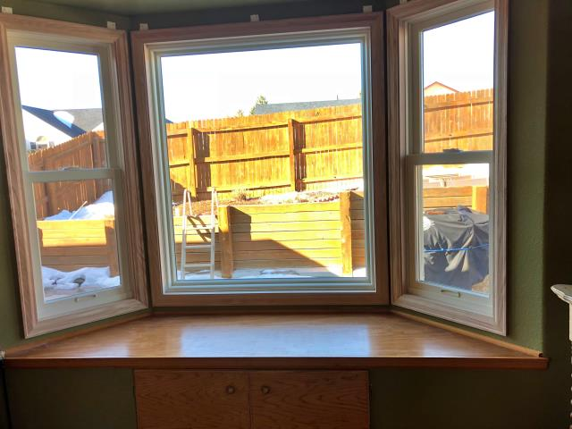 Cheyenne, WY - Our team switched out old wood sash double hung windows with new renewal by Andersen fibrex double hung and a nice new picture window in Cheyenne!