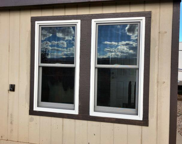 Gillette, WY - Our installers replaced two melted vinyl double hung windows with two new nice fibrex double hungs in Gillette!