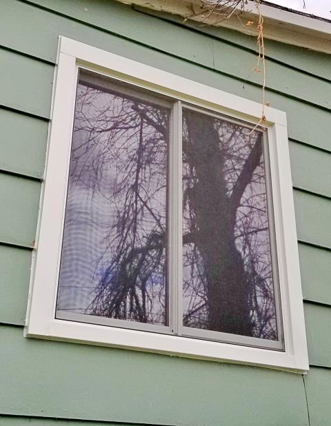 Sturgis, SD - Our professional installers replaced an old leaky wood clad window with this Renewal by Andersen fibrex framed glider on this home in Sturgis.
