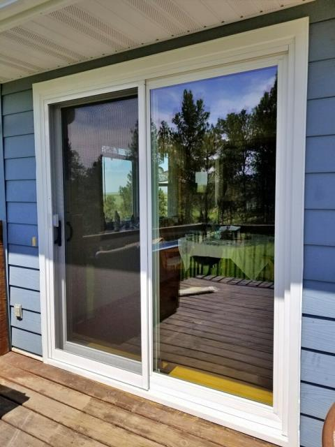 Belle Fourche, SD - Replaced an old patio vinyl glider door with a Renewal by Andersen 200 Series Perma-Shield patio glider door on this home in Belle Fourche.