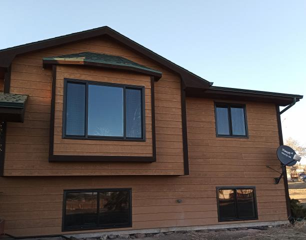 Hermosa, SD - This Hermosa, SD home upgraded their windows to our Energy Efficient Fibrex Windows!
