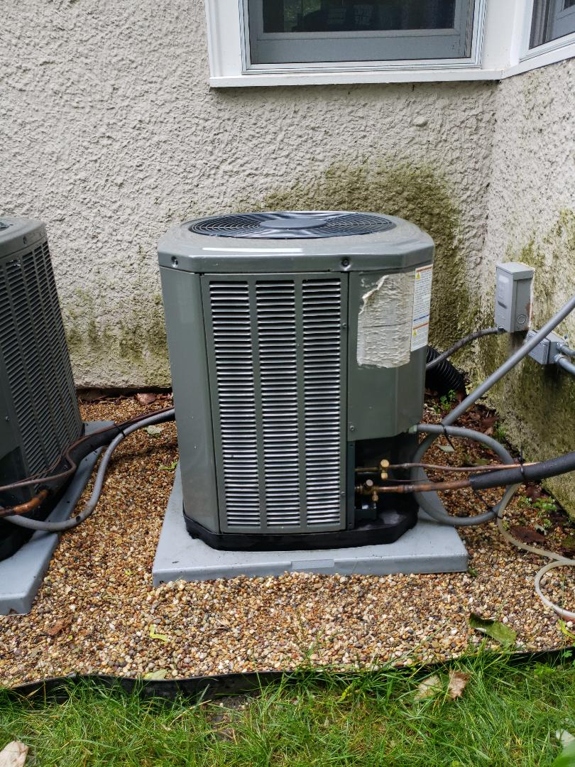 Preformed air conditioner repair and maintenance on Trane central air conditioner near Winnetka Illinois. Summer air conditioner service maintenance can reduce your Air conditioning repair costs and increase the service life of your Air Conditioner. When you need a air conditioner installation or repair North Shore Heating & Cooling provides local air conditioning repair and replacement services near you. https://www.northshoreheatingandcooling.com/special-offers
