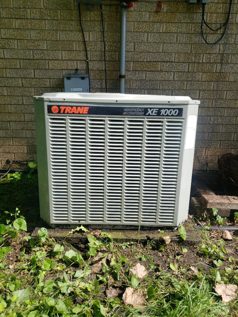 Air Conditioner service call on Trane air conditioner located in Wilmette. Illinois. AC leaking water. Ac repair complete condensate drain purge. North Shore Heating and Cooling is a professional ac repair and ac service contractor as well as specializing in furnace service and furnace repair. Call us today at 847-729-1040 or visit us at www.northshoreheatingandcooling.com