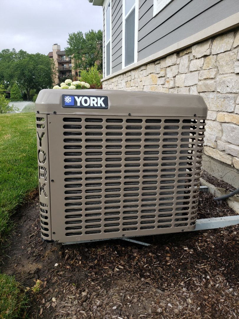 Northbrook, IL - Air conditioner tune-up and safety check up on York air conditioner located in Northbrook Illinois. AC repair system needs Puron refrigerant. Customer purchased yearly maintenance contract. North Shore Heating and Cooling located in Glenview Illinois offers a Preferred Customer Agreement, assuring that your air conditioner and furnace receive yearly cleaning and tune-up as recommended by the manufacturer. Yearly maintenance helps to avoid untimely furnace repair and ac repair. Call today to schedule your tune-up or get a free quote on a yearly maintenance contract at 847-729-1040 or visit us at www.northshoreheatingandcooling.com
