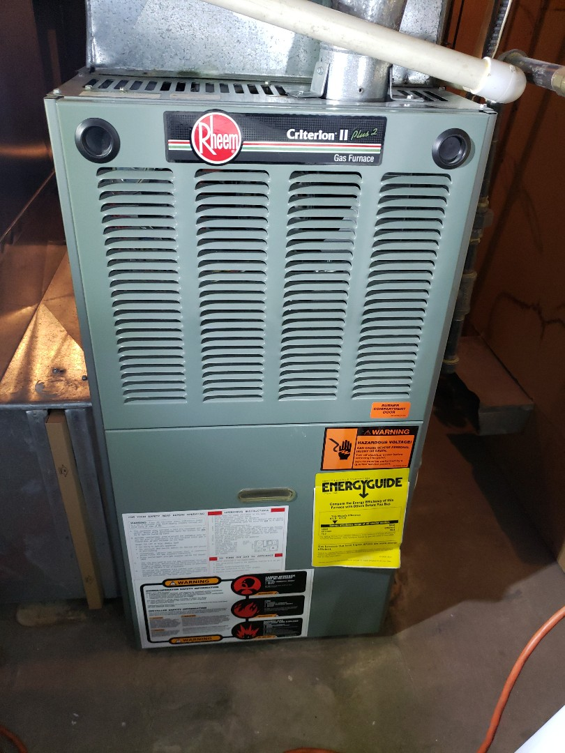 Furnace tune-up on Rheem furnace located in Northbrook, Illinois Call today to schedule your furnace maintenance check up at 847-729-1040 or visit us at www.northshoreheatingandcooling.com/special-offers for free special coupons