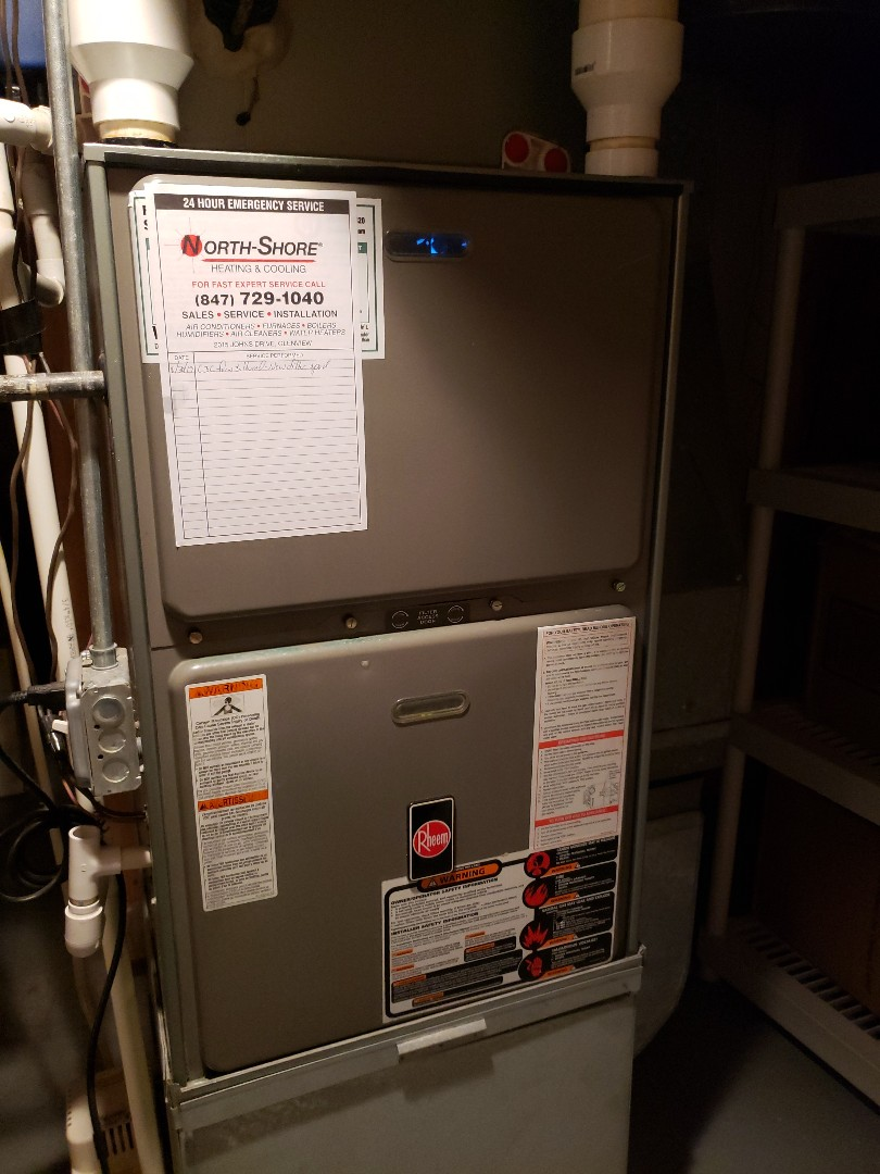 Glenview, IL - Performed Furnace maintenance and furnace tune up on Rheem furnace located in Glenview, Illinois. Performed humidifier maintenance. North Shore heating and cooling is the best HVAC contractor near you. We are centrally located in Glenview Illinois to better service the communities of Northbrook, Highland Park, Deerfield, Riverwoods, Lincolnshire, Wilmette, Winnetka, and Glencoe. Call us today for an appointment for furnace repair, furnace service or furnace replacement at 847-729-1040 or visit us at www.northshoreheatingandcooling.com