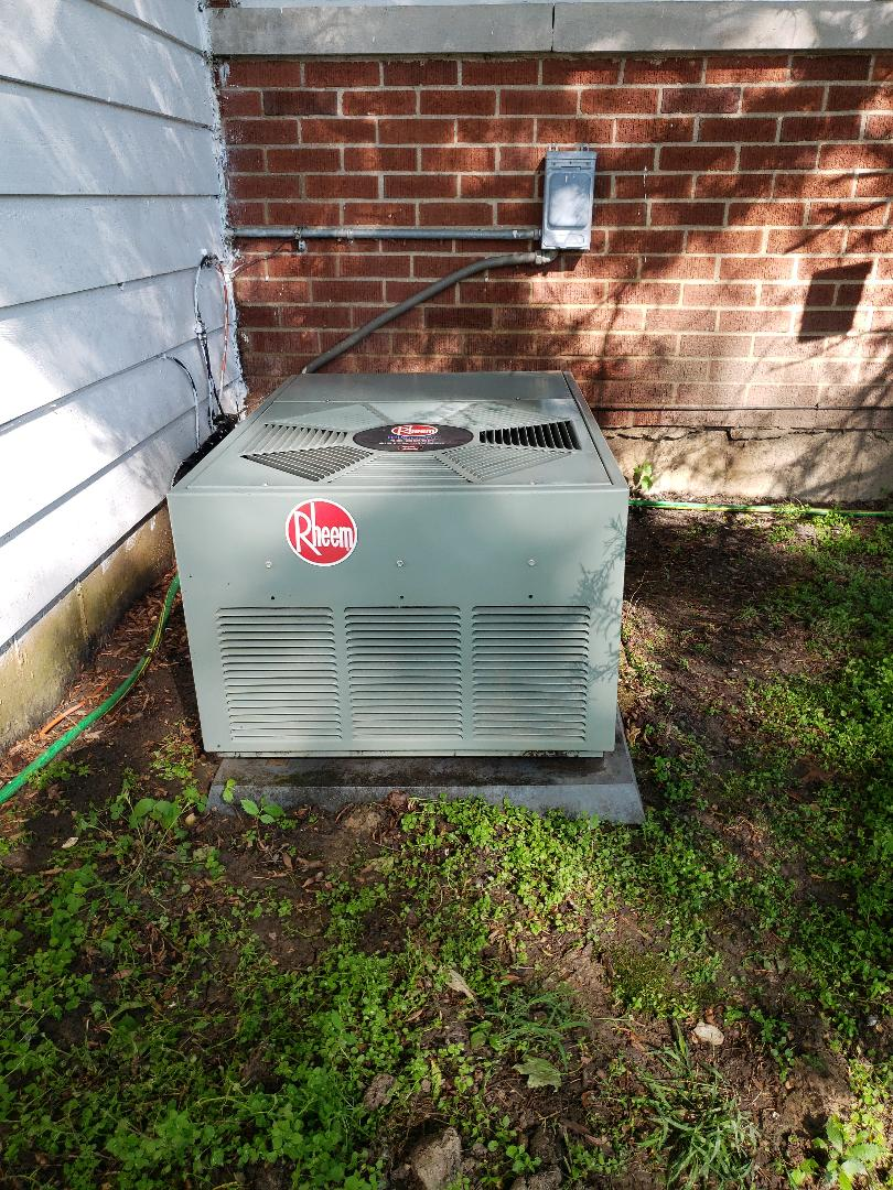 Northbrook, IL - Perform AC cleaning and maintenance on Rheem air conditioner located in Northbrook, Illinois.  Keep you air conditioner running efficiently - Call North Shore Heating and Cooling today to set up you ac tune up at 847-729-1040 and visit our website for coupons and savings at www.northshoreheatingandcooling.com/special-offers.
