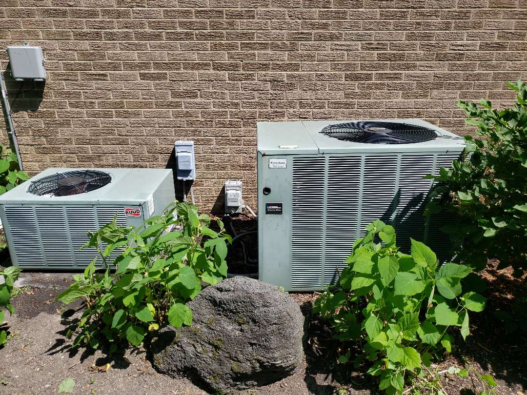 Northbrook, IL - Air Conditioner tune up on a  Ruud air conditioner and American Standard air conditioner located in Northbrook Illinois.  AC maintenance and AC cleaning play important roles in keeping your air conditioner running efficiently. North Shore Heating and Cooling. located near you, in Glenview Illinois, are experts in ac cleaning, ac service and ac repair. Call today to schedule our comprehensive air conditioner maintenance and safety check up at 847-729-1040 and visit our website for special savings and coupons at www.northshoreheatingandcooling.com/special-offers