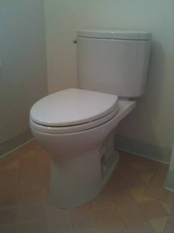 Provide &Install a toto drake 2 elongated toilet in a bone color with soft close seat in the hall bathroom.