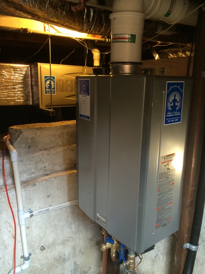 Berkeley, CA - Doing the HERS testing for heating system for a Carrier 95% efficient system. Also note the Rinnai RUR 98i tankless with integral circulation pump. Works like a charm.