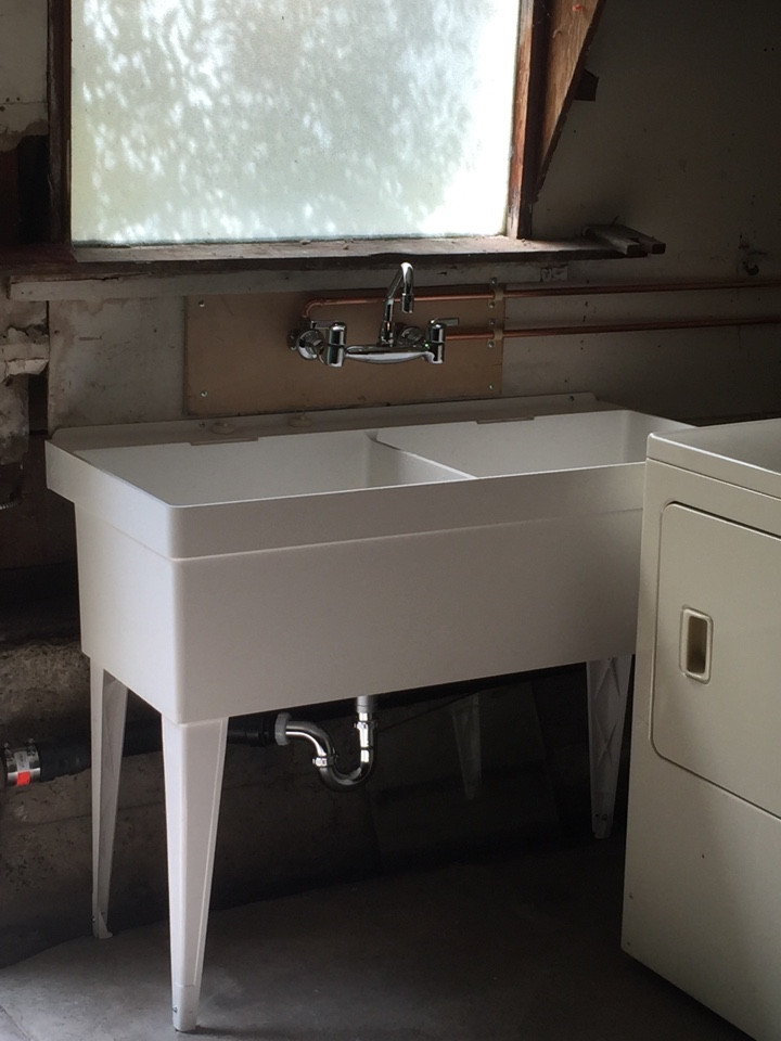 Berkeley, CA - Provide and install new Florestone double bowl utility sink with wall mount faucet in place of concrete sink in basement location at Oregon St. in Berkeley CA