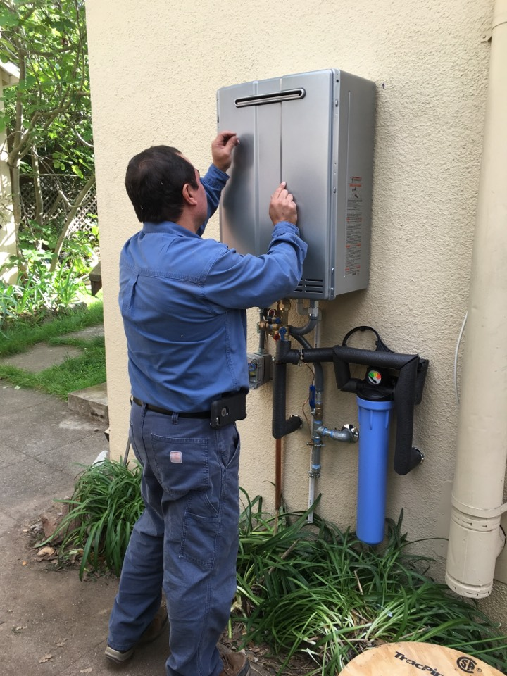 Berkeley, CA - We just finished installing an emergency tankless because the tank water heater leaked from the second floor. A Rinnai RuR 98e did the trick with integral recirculating capabilities for that distant bathroom. Thanks, Nicholas, Alfonso and Tony!