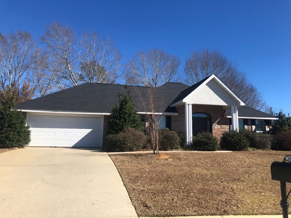 Gulfport, MS - B&M Roofing. This one story family home with two beautiful labs was such a joy to work on. They had unfortunate damage from hurricane Zeta and we were able to help them out by replacing their old three tab shingles with timberline HDZ charcoal gray shingles with a 50 year warranty. This house has beautiful shrubbery landscaping and gorgeous pillars on their front porch. Their neighbors were very polite and the family was sweet as can be.