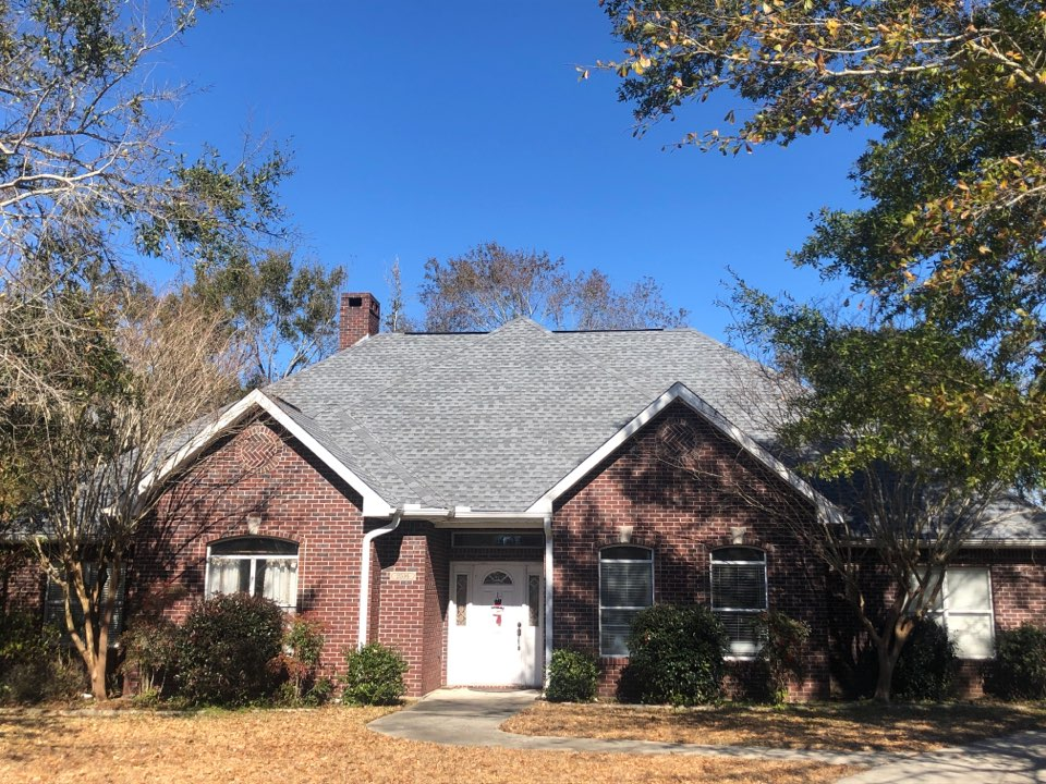 Biloxi, MS - B&M Roofing. This beautiful brick one story family home is surrounded by gorgeous oak trees and rosebushes. Their roof took damage and hurricane Zeta and had a loss of their three tab shingles. Our company provided them with timberline HD Z pewter gray shingles with a 50 year warranty for some peace of mind when the next storm hits. Their pups were precious and their neighbors were very friendly. We enjoyed working with them and their neighborhood greatly.