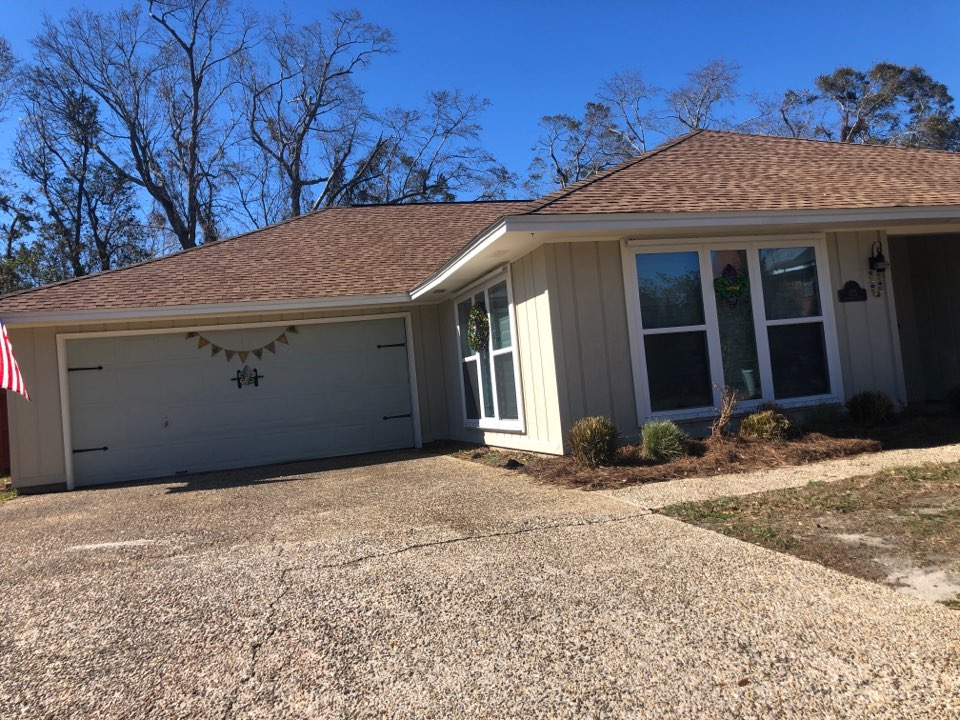 Gulfport, MS - This quaint one story cottage is right across the street from the shimmering gulf coast beaches. The wind gusts from hurricane Zaida unfortunately tour there's three tab shingles off of the roof. Our company was able to do an entire roof replacement with timberline HD ZGAS Shakewood shingles. They offer a 50 year warranty giving peace of mind to this wonderful friendly family and they're adorable pets. Their neighbors were sweet and accommodating as well.