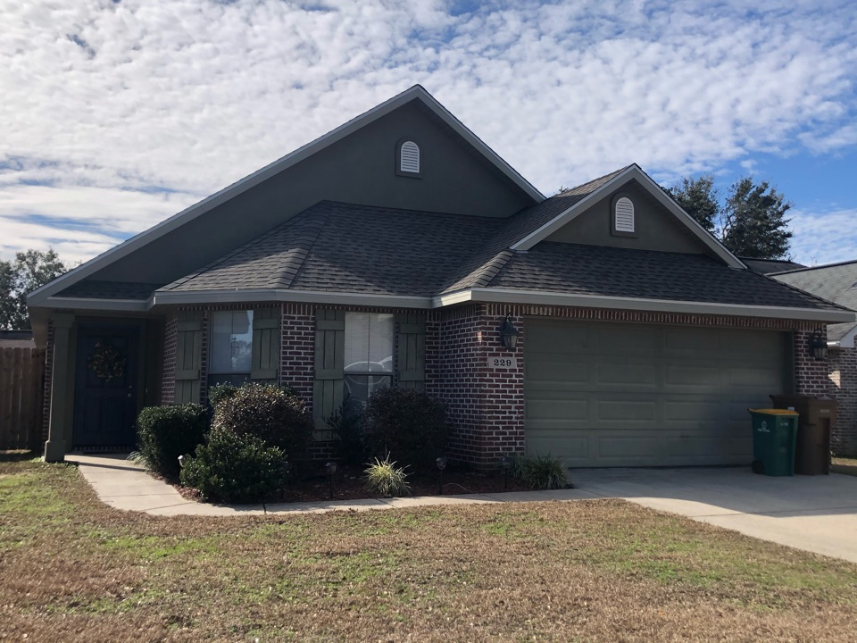 Long Beach, MS - The sweet one story home had severe roof damage during hurricane Zeta. B&M roofing replaced their old three tab shingles with GAF timberline HDZ architectural shingles in Weatherwood.