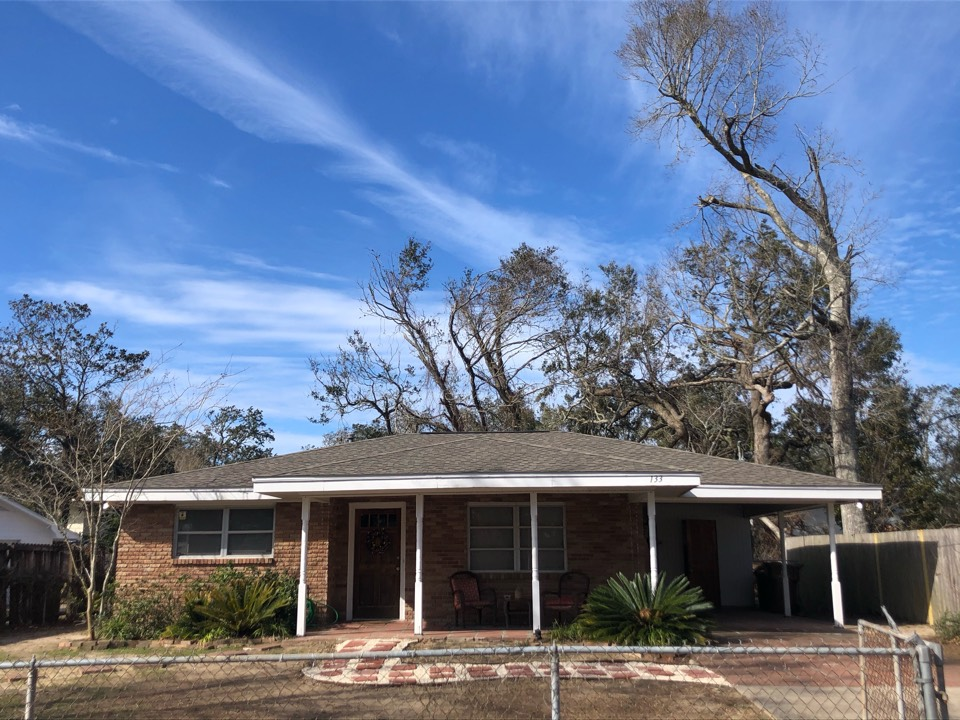 Pass Christian, MS - This cute one story home to the roof damage in hurricane zeta. B&M roofing replace their old three tab shingles with GAF timberline HDZ architectural shingles in the color Weatherwood.