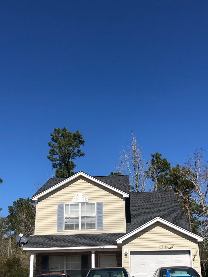 Gulfport, MS - This sweet two-story home took severe roof damage in hurricane Zeta. B&M roofing was able to give them a brand new GAS timberline HD Z architectural shingles in the color charcoal.