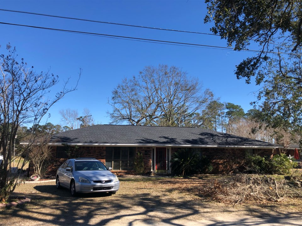 Biloxi, MS - This one story home took roof damage during hurricane Zeta. B&M Roofing replaced their old three tab shingles with a bold GAF timberline HDZ architectural shingles in charcoal.