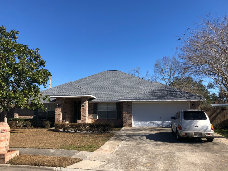 Biloxi, MS - This gorgeous one story home suffered damage to the roof from the wind gusts of a hurricane Zeta. B&M Roofing was able to give them a new sleek roof with GAF timberline HDZ architectural shingles in Oyster Grey.
