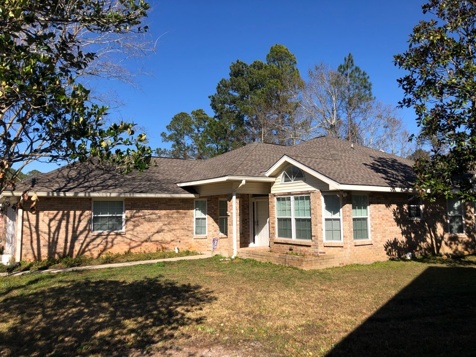 Gulfport, MS - This beautiful, spacious one story home text of your roof damage in hurricane Zeta. B&M Roofing replace their old three tab shingles with GAF timberline HDZ architectural shingles in Weatherwood.