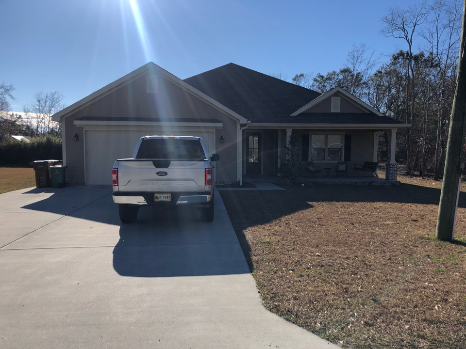 Long Beach, MS - This cute one story home had roof damage from hurricane Zeta. B&M Roofing replace their old three tab shingles with GAF timberline HDZ architectural shingles in Weatherwood.