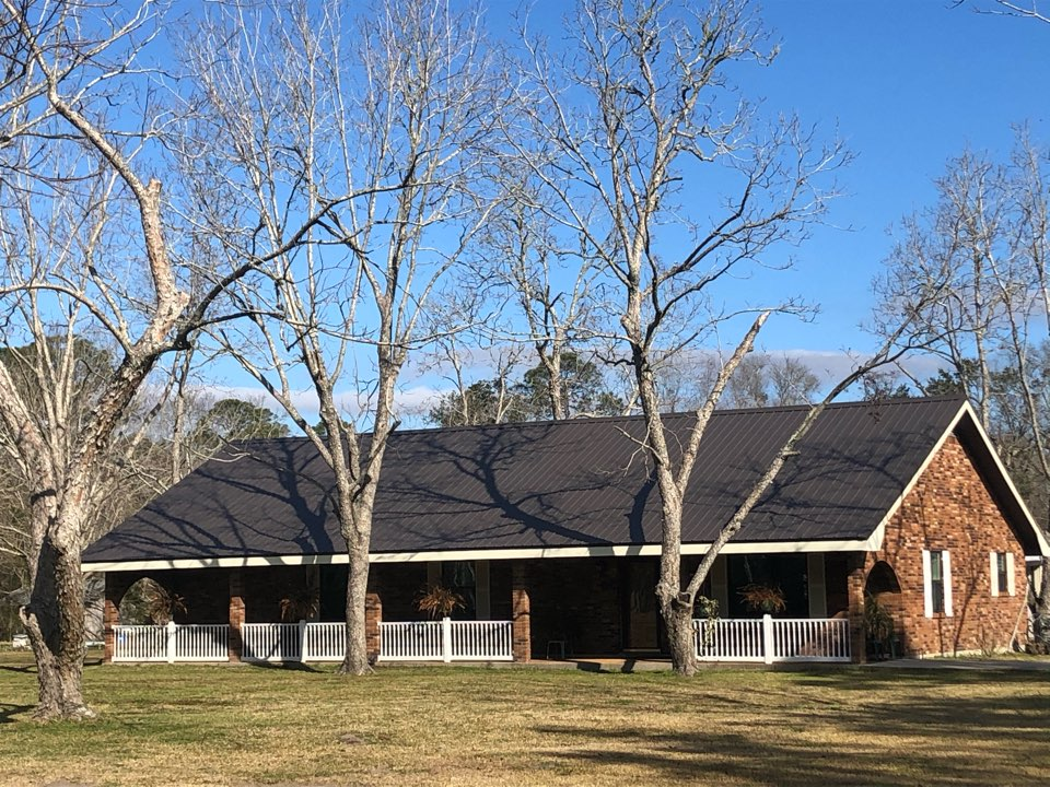 Long Beach, MS - B&M Roofing replaced this beautiful one story roof with a brand new Costal Metals sleek grey metal roof.