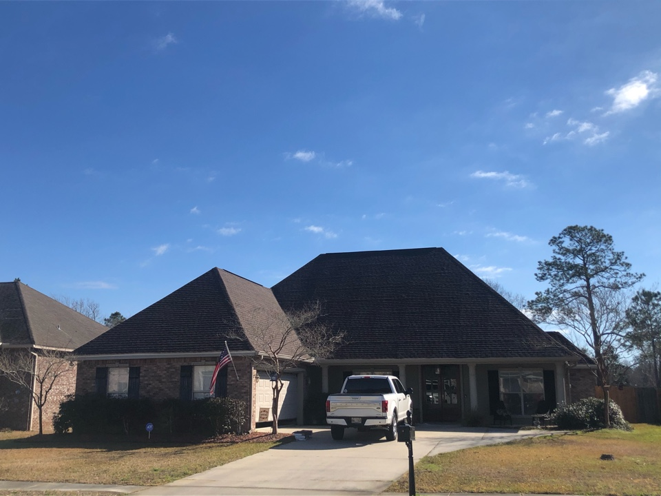 Long Beach, MS - This gorgeous home had unfortunate roof damage during Hurricane Zeta. B&M Roofing replaced their entire roof using GAF Lifetime Series Timberline HDZ shingles in Barkwood.