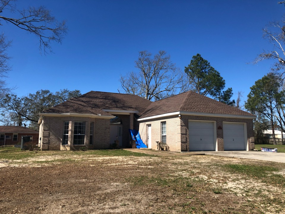 Gulfport, MS - This adorable one story home had roof damage during Hurricane Zeta. B&M Roofing provided this family with a brand new GAF lifetime series timberline HDZ shingle roof in the color Barkwood.