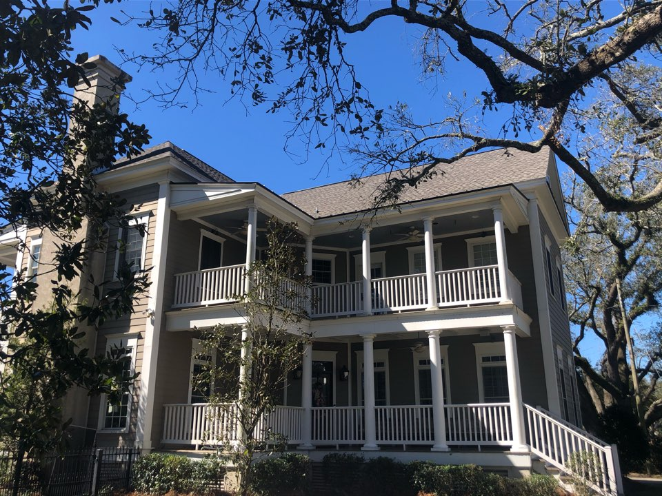 Gulfport, MS - B&M Roofing provided this stunning two story home with a brand new whole reroof using GAF lifetime series timberline architectural HDZ shingles in Weatherwood!
