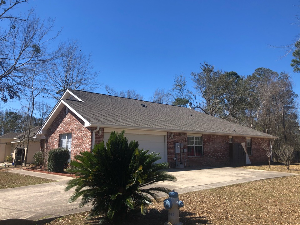 Diamondhead, MS - This one story house took damage to their roof during Hurricane Zeta. B&M Roofing provided them with a brand new GAF lifetime series timberline architectural HDZ shingle roof in weatherwood!